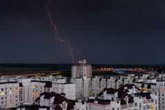 Lightning in the night sky over the city houses Stock Image
