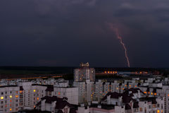 Lightning in the night sky over the city houses Royalty Free Stock Photography