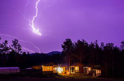 Lightning in the night sky over houses Royalty Free Stock Photos