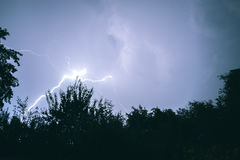 Lightning night thunderstorms in a summer night in the village. Royalty Free Stock Photography