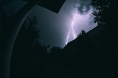 Lightning night thunderstorms in a summer night in the village. Royalty Free Stock Photo