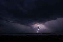 Lightning and the Ocean. Horizontal photography of a storm and lightning strike over the ocean Stock Photo