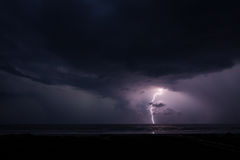 Lightning and the Ocean. Horizontal photography of a storm and lightning strike over the ocean Royalty Free Stock Image