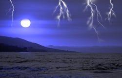 Lightning ocean. Lightning striking over the dark ocean Royalty Free Stock Photos