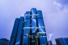 Lightning and Office Building Royalty Free Stock Images