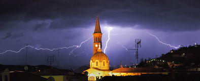 Lightning over Alba and surrounding hills. Stock Photo