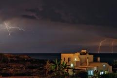 Lightning over beach house. Lightning storm over sea and beach house Royalty Free Stock Photos