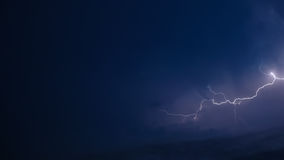 Lightning over blue Stock Images