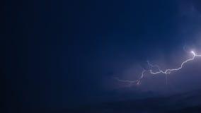 Lightning over blue. Single lightning glowing over blue cloud background Stock Images