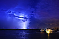 Lightning over boats and water Stock Photography