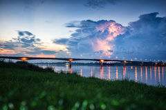 Lightning over the bridge. Of thai and lao friendship bridge; forground is blur soft focus royalty free stock photo