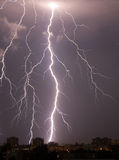 Lightning over the city. A burst of lightning bolts over the city Stock Photography