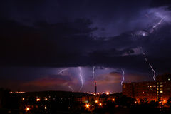 Lightning Over The City. Dark night and lightning over the city Royalty Free Stock Photos