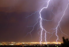 Lightning over the city. Lightning over the Salt Lake Valley royalty free stock photos