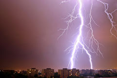 Lightning over city Stock Images