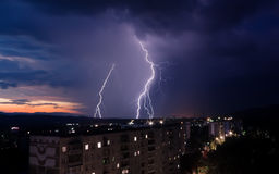 Lightning over a city. A lightning over a city at night Royalty Free Stock Photos