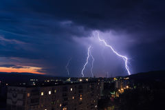 Lightning over a city. A lightning over a city at night Royalty Free Stock Images