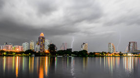 Lightning over city. Built cloud Stock Photography