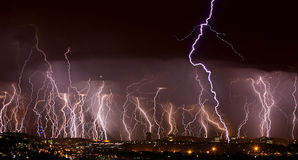 Lightning over city. Image of multiple lightning strikes over city Royalty Free Stock Photos