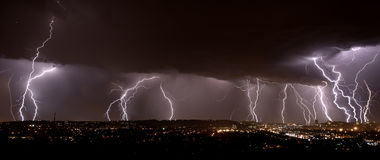 Lightning over city Stock Image