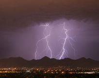 Lightning over the City and Mountains. Cloud to ground Stock Images