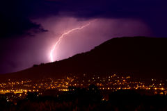 Lightning over city. By night Royalty Free Stock Photography