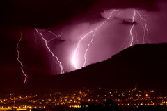 Lightning over city. By night Royalty Free Stock Images
