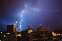 Lightning over the city. Of night Royalty Free Stock Photo