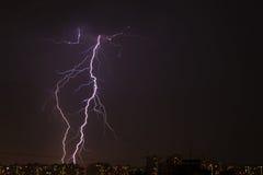 Lightning over the city Stock Photos