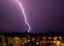 Lightning over the city at night. Summertime thunderstorm Royalty Free Stock Image
