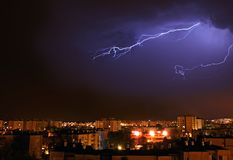 Lightning over the city at night Stock Images