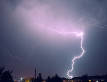 Lightning over the city. Powerfull flash at night Royalty Free Stock Photo