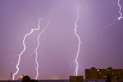 Lightning over city skyline. Bolts of lightning over city skyline, night scene Royalty Free Stock Photo