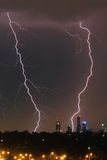 Lightning over city skyline Stock Photos