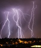 Lightning over city skyline Royalty Free Stock Images