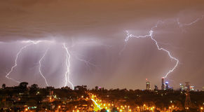 Lightning over city skyline Royalty Free Stock Photo
