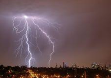 Lightning over city skyline Stock Images