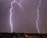 Lightning over city skyline Royalty Free Stock Image