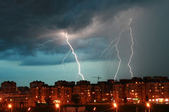 Lightning over the city. Lightning during a thunderstorm in Moscow Stock Photos