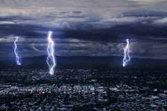 Lightning over city. View of a lightning over city at night Stock Photos