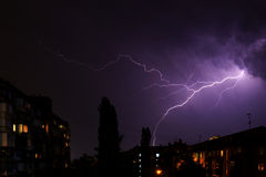 Lightning over the city was broken by the sky. City Royalty Free Stock Photo