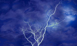 Lightning over dark blue sky. Atmosphere bright lightning over dark blue sky Royalty Free Stock Photography