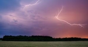 Lightning over field Royalty Free Stock Photos