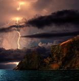 Lightning over Karadag. Eastern Crimea, near Feodosia. Lightning sparkle over the Black Sea, Eastern Crimea, near Feodosia and Koktebel. In the distance you can royalty free stock photo