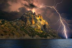 Lightning over Karadag. Eastern Crimea, near Feodosia. Lightning sparkle over the Black Sea, Eastern Crimea, near Feodosia and Koktebel. In the distance you can royalty free stock photography