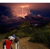 Lightning over Karadag. Eastern Crimea, near Feodosia. Lightning sparkle over the Black Sea, Eastern Crimea, near Feodosia and Koktebel. A group of tourists goes stock images