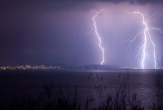 Lightning over the lake Royalty Free Stock Photos
