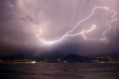 Lightning over the mountains and lake Royalty Free Stock Photo