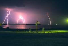 Lightning Over The Ocean. Bolts of lightning touch down over the Atlantic ocean across Casco Bay in Portland, Maine Stock Photos
