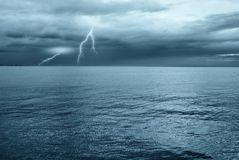 Lightning over the ocean. In the evening Stock Photography
